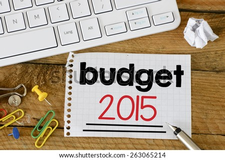 Budget 2015 Sign with pen. Budget 2015 Sign with pen and keyboard on wooden background - stock photo