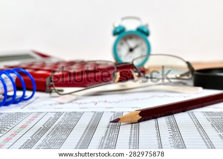 budget stats, pencil and calculator on table - stock photo