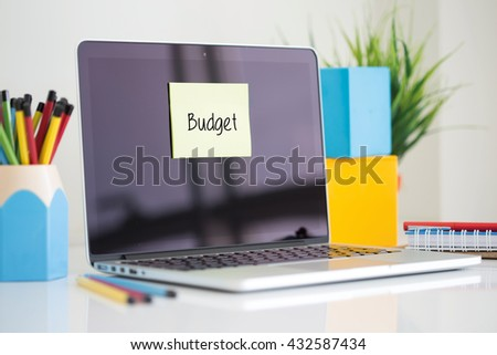 Budget sticky note pasted on the laptop - stock photo