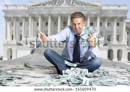 Budget United States. Businessman sitting on dollars banknotes  - stock photo