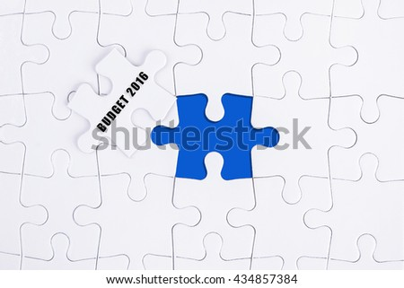 BUDGET 2016, WHITE AND BLUE MISSING PUZZLE WITH COPY SPACE AREA