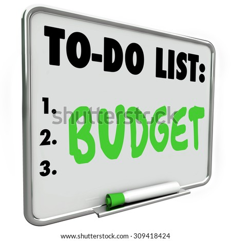 Budget word written on to-do list with green marker or pen to illustrate importance of planning costs and income to save money - stock photo
