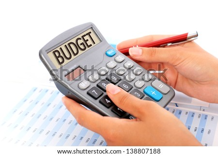 Budgeting concept. Hands, pen and calculator. - stock photo