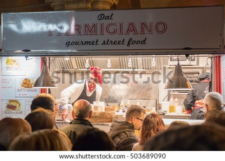 BUDRIO, ITALY - October 22, 2016: The traditional Italian cuisine on the road. Food served by small trucks around the streets.