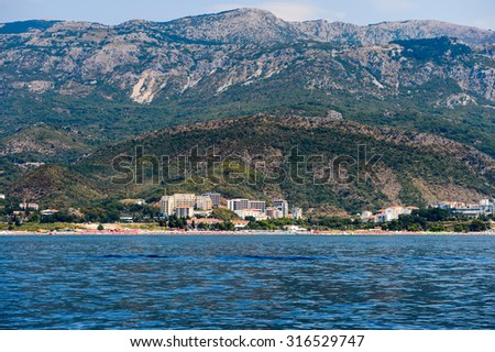 BUDVA, MONTENEGRO - AUG 13, 2015: Coast of Budva resort on the Adriatic sea. Adriatic sea has a catchment area of 235 000 km2