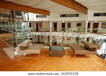 BUDVA, MONTENEGRO - JULY 29, 2011: Modern hotel lobby with contemporary armchairs in Budva, Montenegro. selective focus - stock photo