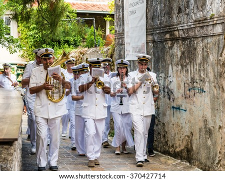 BUDVA,MONTENEGRO - JUNE 08, 2014: Marine brass band on the streets of Budva on the feast of St. Trinity