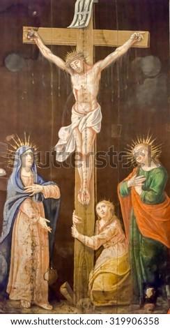 BUDVA, MONTENEGRO - SEPTEMBER 05, 2012: Crucifixion, Blessed Virgin Mary and Saint John under the cross, Saint John the Baptist catholic church in Budva, Montenegro - stock photo