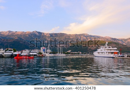 BUDVA, MONTENEGRO - SEPTEMBER 15, 2015: Pleasure yachts at the pier Dukley Marina on the waterfront of resort of Budva, Montenegro - stock photo