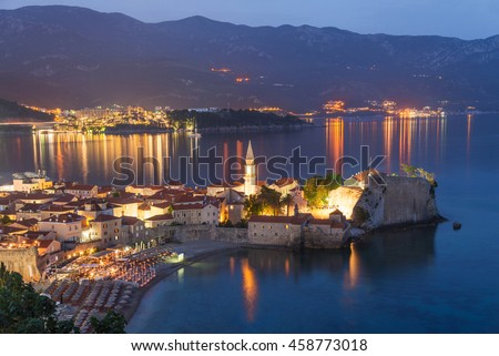 Budva old medieval walled city lights at night. Center of Montenegrin tourism, medieval walled city at Adriatic sea coastline. Montenegro. Europe. - stock photo