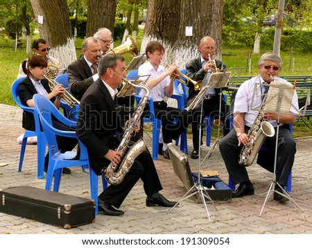 BUDYONNOVSK, STAVROPOL REGION, RUSSIA - MAY 1, 2014: municipal brass band on the Labor Day celebration, on 1st of May 2014, in Budyonnovsk, Russia. - stock photo