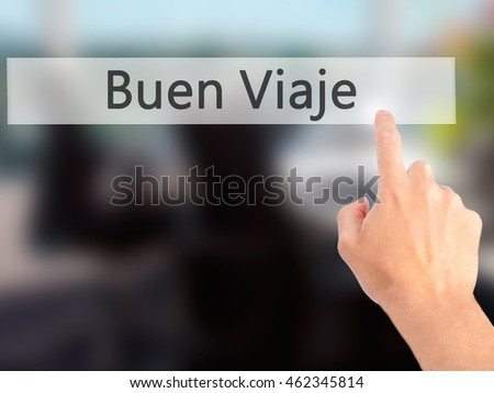 Buen Viaje (Good Trip in Spanish) - Hand pressing a button on blurred background concept . Business, technology, internet concept. Stock Photo