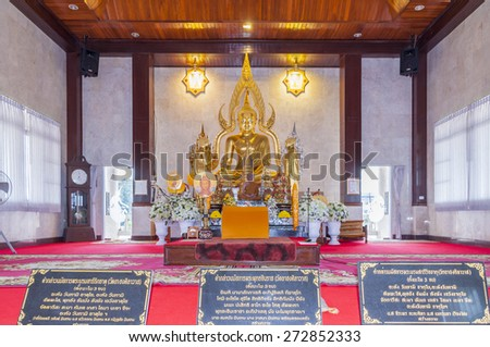 Bueng Kan, Thailand- March 21, 2015: decorated set of altar table in main chapel of Wat Ahong Silawad