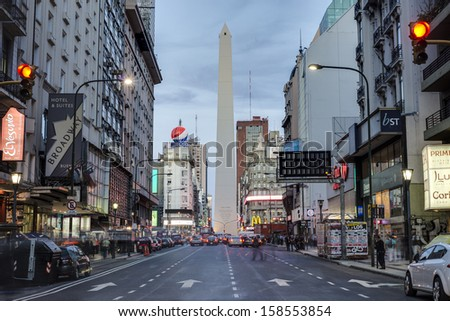 BUENOS AIRES, ARGENTINA - APR 09: The Obelisk (El Obelisco), the most recognized landmark in the capital on Apr 09, 2013 in Buenos Aires, Argentina. - stock photo
