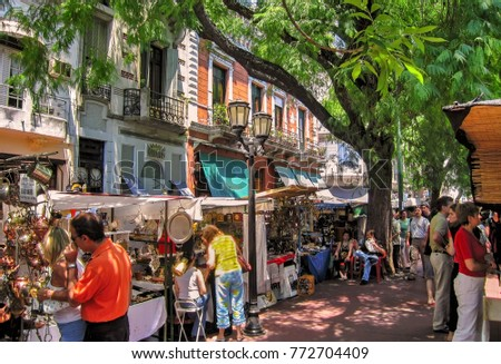 Buenos Aires, Argentina. Circa November 2012. Tourists visit popular San Telmo outdoors market in old town Buenos Aires.