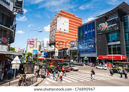 BUENOS AIRES, ARGENTINA - FEB 15, 2014: Building and traffic of the Avenida del Libertador (Liberator Avenue) which is one of the thoroughfares in Buenos Aires, Argentina. It extends 25 km to north