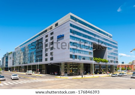 BUENOS AIRES, ARGENTINA - FEB 15, 2014: Hotel Hilton of Puerto Madero. Port is named afret Eduardo Madero who was in charge of the construction of the port in 1882
