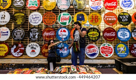BUENOS AIRES, ARGENTINA - MARCH 5, 2016: Two unidentified sellers of street art at San Telmo street fair
