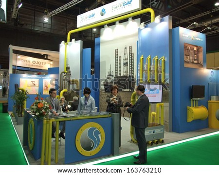 BUENOS AIRES, ARGENTINA - 5-9 OCTOBER 2009: Unknown people work on the  stand of company 'Nafto-Gas Ukraine'� on the 24th World Gas Conference on October 5-9, 2009 in Buenos Aires, Argentina.  - stock photo