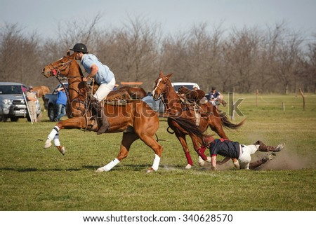 BUENOS AIRES, ARGENTINA - SEP 19: Fiesta de la Tradicion. Players in the national game of Argentina Pato. This game of gauchos created in the 19 century. September 19, 2015, Buenos Aires, Argentina