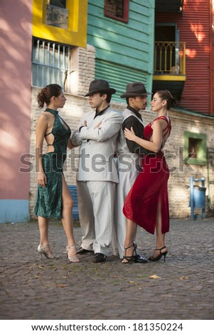 BUENOS AIRES - MARCH 28: Four unidentified tango dancers pose as two couples dressed for a party on March 28, 2010 in Buenos Aires, Argentina. - stock photo