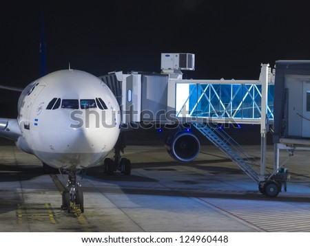 BUENOS AIRES - OCTOBER 5: A plane being loaded at Ezeiza International Airport October 5, 2012 in Buenos Aires, Argentina. It is the only Latin American airport that operates flights to all continents. - stock photo