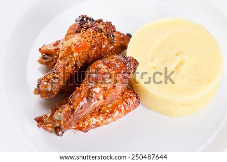 Buffalo chicken wings and mashed potatoes - stock photo