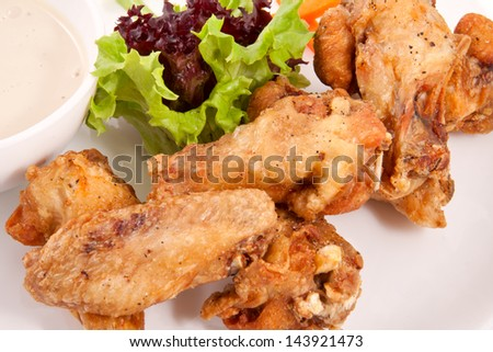 Buffalo chicken wings on plate