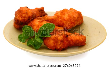 buffalo chicken wings on plate isolated on white