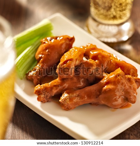 buffalo chicken wings with beer - stock photo