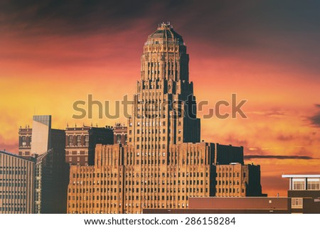 Buffalo City Hall Sunset. Buffalo City Hall and the Buffalo, New York skyline during sunset. Edited with a vintage look. (Public buildings, no release needed.) - stock photo