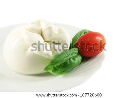 Buffalo mozzarella Burrata, basil and tomatoes - stock photo