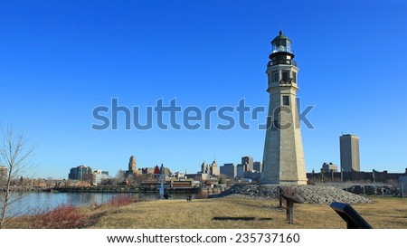 Buffalo North Breakwater Lighthouse at day with the city in the background - stock photo