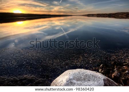Buffalo Pound Lake Saskatchewan at sunset Canada - stock photo