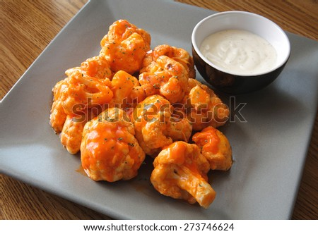 buffalo-style cauliflower dish with ranch sauce - stock photo