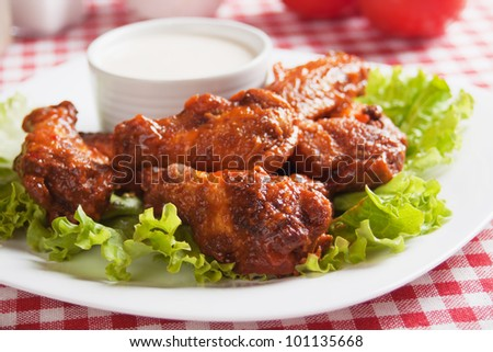 Buffalo style chicken wings with blue cheese dip - stock photo
