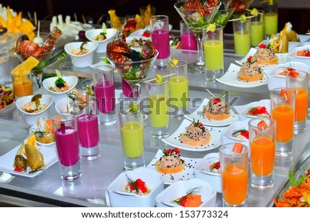 buffed food closeup of sandwiches and fresh juice arranged on  table - stock photo