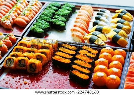 buffet catering style Sushi Set in restaurant - Different Types of Maki Sushi and Nigiri Sushi - stock photo