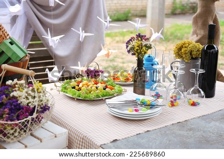 Buffet table with dishware waiting for guests - stock photo