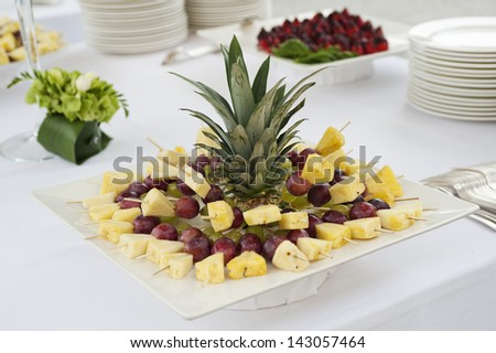 buffet table with fruit skewers - stock photo