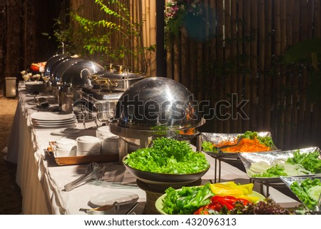 Buffet Table with Row of Food Service Steam Pans.