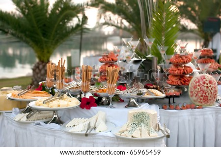 Buffet table with seafood with cheese in the foreground