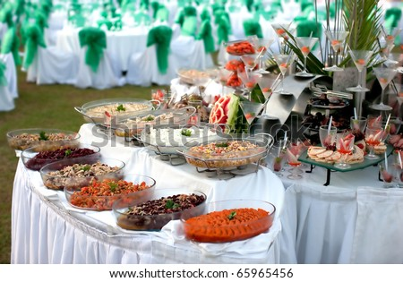 Buffet table with seafood with Salads in the foreground - stock photo