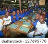 BUIKWE REGION, UGANDA - JULY 26: An unidentified children at the village school on July 26, 2004 in Buikwe region, Uganda. Most children can walk to school thanks to foreign charity - stock photo