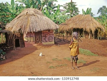 BUIKWE REGION, UGANDA - JULY 26: Traditional african huts in East Africa on July 26, 2004 in Buikwe region, Uganda. Uganda is one of the poorest countries in the world. - stock photo