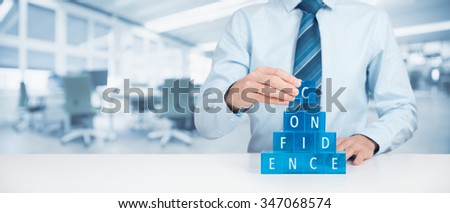 Build confidence - self-confidence improvement concept. Coach or mentor helps build confidence. Wide banner composition with office in background. - stock photo