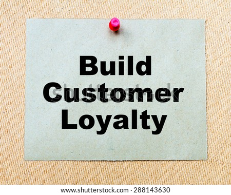 Build Customer Loyalty written on paper note pinned with red thumbtack on wooden board. Business conceptual Image - stock photo