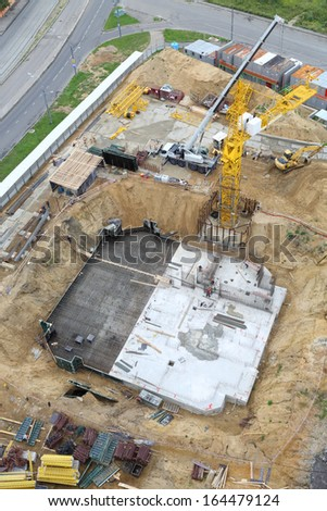 Build of tower crane, building foundation and machines at construction site. - stock photo