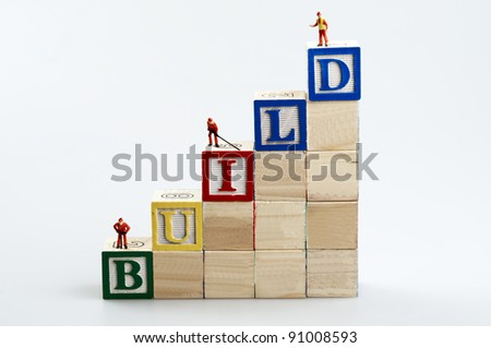 Build word and business man toy