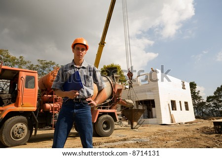 Builder at the machine for transportation of concrete. - stock photo